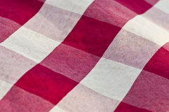 Picnic blanket. A close up of a red and white picnic blanket Stock Photography