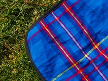 Picnic blanket on the lawn Stock Images