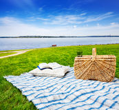 Picnic blanket, pillow & basket Royalty Free Stock Photography