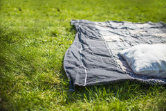 Picnic blanket with pillow on the grass. Field Royalty Free Stock Photos