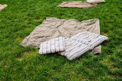 Picnic blanket with pillow on the grass field. Picnic blanket with pillow on the beautiful grass field Stock Image