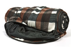 Picnic blanket. Rolled picnic blanket with a lower layer of teflon against moisture Stock Photography