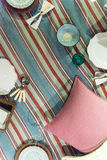 Picnic Blanket Scene. Traditional Classic Picnic Blanket Scene Set out with plates, cushions and cutlery Stock Photo