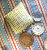Picnic Blanket Scene. Traditional Classic Picnic Blanket Scene Set out with plates, cushions and cutlery Royalty Free Stock Image