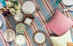 Picnic Blanket Scene. Traditional Classic Picnic Blanket Scene Set out with plates, cushions and cutlery Stock Photography