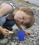 Picnic break. Young boy eating a slice of apple outdoors Stock Photography