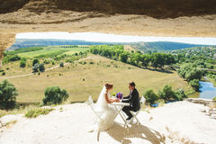 Picnic in Cave. Couple having picnic in cave at sunny day Royalty Free Stock Images