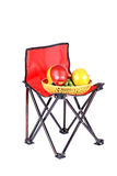 Picnic chair and fruits Stock Images