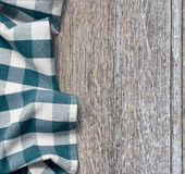 Picnic cloth over old wooden table grunge. Background Royalty Free Stock Image