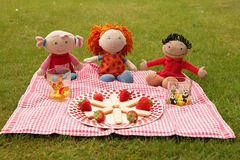 Picnic. Colorful and happy dolls having a picnic in the park Royalty Free Stock Photography