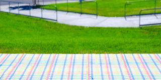 Picnic colorful tablecloth on the table Stock Images