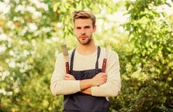 Free Picnic Concept. Bbq Chef. Handsome Guy Cooking Food. Grilling Food. Barbecue Utensils. Cooking Burgers. Man Hold Royalty Free Stock Images - 218043799