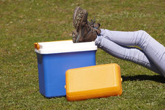 Picnic cooler in the grass and trekking boots in Spain Royalty Free Stock Image