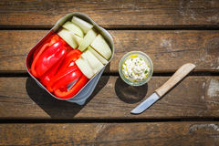 Picnic, Dip and crudites, paprika and kohlrabi. On wooden background Royalty Free Stock Photo