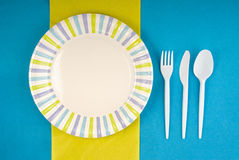 Picnic disposable dishware setting. On paper tablecloth Royalty Free Stock Images
