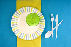 Picnic disposable dishware setting. Picnic disposable dishware on paper tablecloth Royalty Free Stock Photography