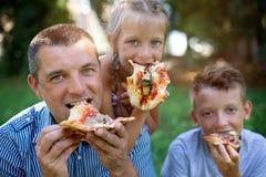 Picnic. Family eating pizza Stock Photo