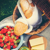 Picnic Food. Selective focus on Fresh Bread. Picnic Food. Fresh Bread, Strawberry, cheese and  honey on a sacking cloth, selective focus, toned Royalty Free Stock Photos