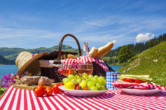 Picnic in french alpine mountains with lake Stock Photography