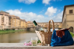 Picnic in Front of the Ponte Vecchio in Florence Stock Photo