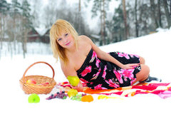 Picnic with fruit on snow Stock Photo