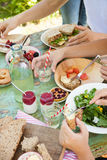Picnic fun. Fresh food on a picnic table outdoors on a summer day Stock Photos