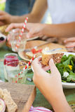 Picnic fun. Female hands spreading butter on a piece of wholegrain bread Stock Images