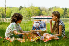 Picnic fun. Young children enjoying a picnic in the summer Stock Photos