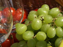 Picnic: grapes and glasses, closeup Royalty Free Stock Photography