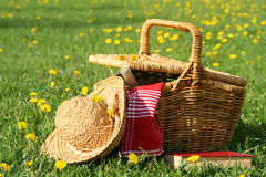 Picnic on the grass. Picnic basket and straw hay laying on the grass stock image