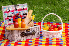 Picnic on the grass. Picnic basket with vegetables and bread. A Stock Photos
