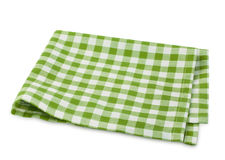 Picnic green clothes folded isolated. Green checkered picnic clothes isolated.Decorative cotton napkin.Plaid gingham towel Royalty Free Stock Photo
