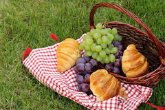Picnic on green grass with  croissants Stock Photo