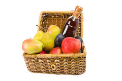 Picnic hamper with fruits and wine. Isolated on the white background Stock Photography