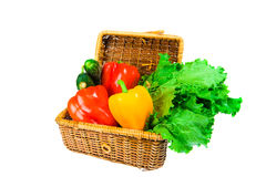 Picnic hamper with vegetables. Isolated on white background Royalty Free Stock Photo