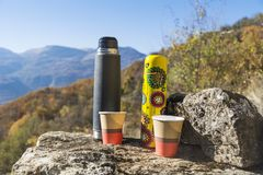 Picnic in the high autumn mountain with two thermoses Stock Image