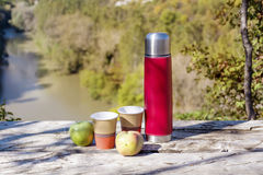 Picnic in the high mountain with red thermos,coffee and apples Stock Photography