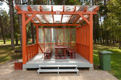 Picnic house at the campsite. With wooden table and bench Royalty Free Stock Photography