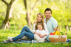 Picnic. Image of happy young family having picnic outdoors Royalty Free Stock Image