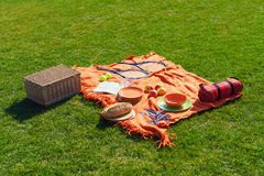Picnic items on a green, well-groomed lawn Royalty Free Stock Photo