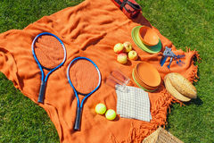 Picnic items on a green, well-groomed lawn Stock Photography