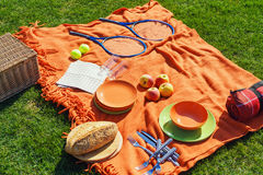 Picnic items on a green, well-groomed lawn Royalty Free Stock Photos