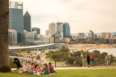 Picnic Perth skyline Australia. Group of people having a picnic in Kings Park with Perth in background Royalty Free Stock Images