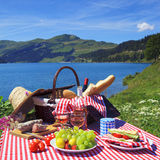 Picnic and lake. Picnic in beautiful french alpine mountain royalty free stock images