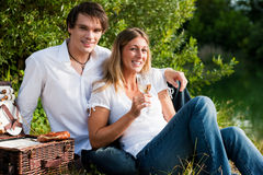 Picnic at the lake with wine in summer Stock Photography