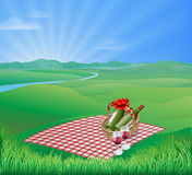 Picnic landscape. Picnic blanket and red wine in natural landscape. Romantic scene Royalty Free Stock Photo