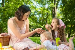 Picnic - mother with children Royalty Free Stock Photography