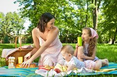 Picnic - mother with children Stock Photo