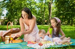 Picnic - mother with children in park Royalty Free Stock Image