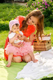 Picnic, mother feeds her baby Royalty Free Stock Photo